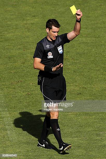 Referee Jarred Gillett shows a yellow card during the round 18 ALeague match between Wellington Phoenix and Perth Glory at Westpac Stadium on...