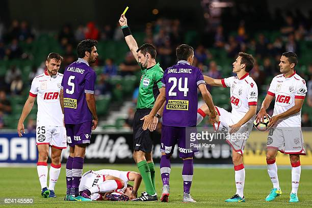 Referee Jarred Gillett shows Rhys Williams of the Glory the yellow card after a tackle on Sergi Guardiola of Adelaide during the round seven ALeague...