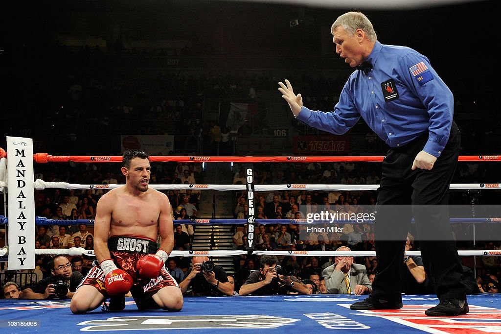 Referee Jay Nady counts as Robert Guerrero kneels on the canvas after being hit by Joel Casamayor in the 10th round of their junior welterweight...