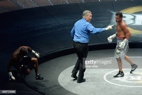 Referee Jay Nady directs David Estrada away from Eddie Caminero after Estrada knocked him into the safety zone during the seventh round of their...