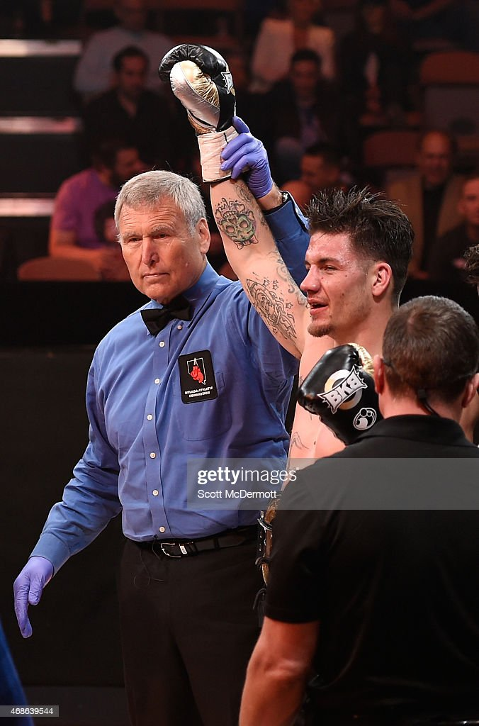 Referee Jay Nady holds up Anthony Johnson's arm as he celebrates his win against Joey Montoya during BKB 2 Big Knockout Boxing at the Mandalay Bay...