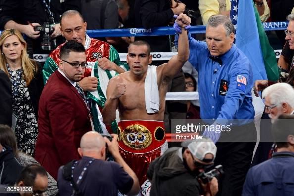 Referee Jay Nady holds up Carlos Molina's arm as he celebrates his splitdecision victory over Ishe Smith in their IBF junior middleweight title fight...
