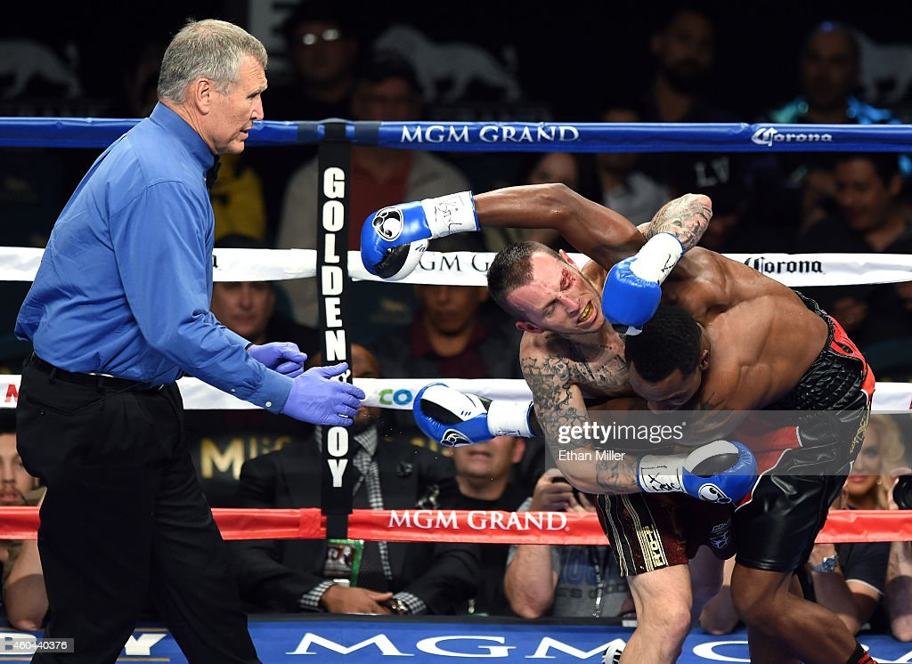 Referee Jay Nady moves in as Lenny Bottai and Jermall Charlo get tangled up in the second round of their junior middleweight fight at the MGM Grand...