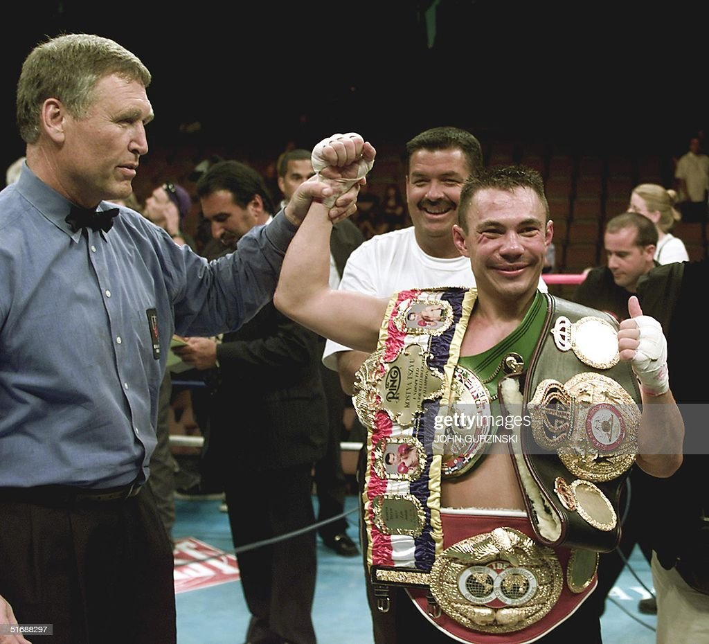 Referee Jay Nady raises the arm of Australia's Kostya Tszyu after Tszyu won a unanimous decision to retain his undisputed world super lightweight...