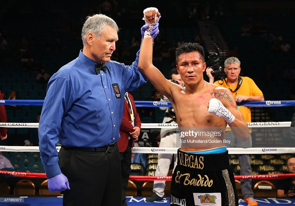 Referee Jay Nady raises the arm of Francisco Vargas after his 10 round unanimous decision win over Abner Cotto at the MGM Grand Garden Arena on March...