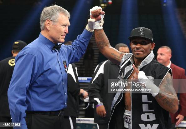 Referee Jay Nady raises the arm of Lanell Bellows after his 2nd round knockout win over Thomas Gifford during their super middleweight fight at the...