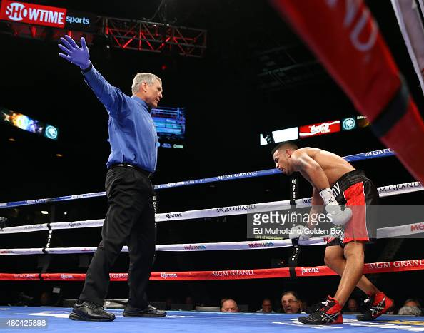 Referee Jay Nady stops the bout between Yoshihiro Kamegai and Oscar Godoy at the MGM Grand Garden Arena on December 13 2014 in Las Vegas Nevada...