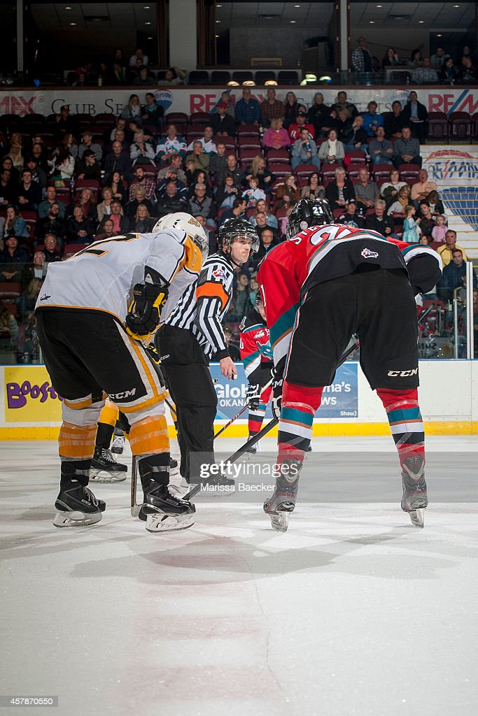 Referee Jeff Ingram prepares to drop the puck at centre ice between the Kelowna Rockets and the Brandon Wheat Kings on October 25, 2014 at Prospera Place in Kelowna, British Columbia, Canada.