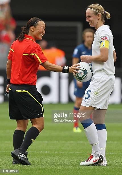 Referee Jenny Palmqvist of Sweden holds the football at Faye White of England during the FIFA Women's World Cup 2011 Quarter Final match between...