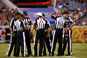 Referee Jerome Boger talks with the officiating crew during the preseason game between the Jacksonville Jaguars and the Tampa Bay Buccaneers at...