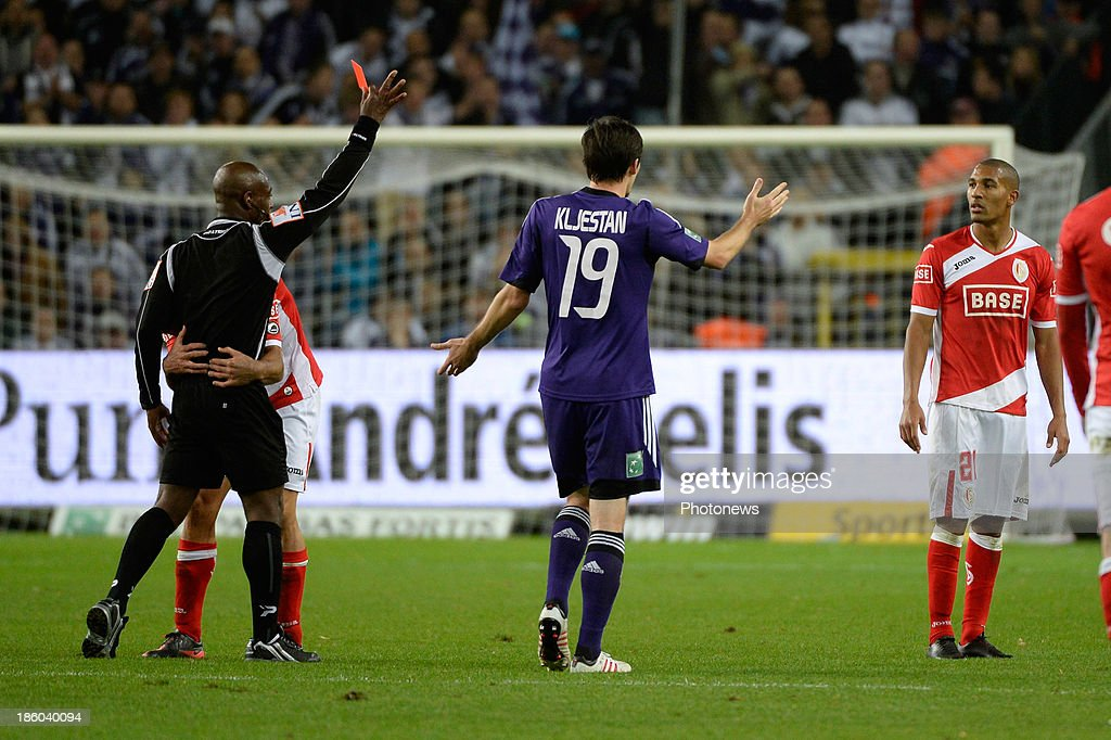 referee Jerome Efong Nzolo show the red card for William Vainqueur of Standard during the Jupiler League match between RSC Anderlecht and Standard Liege on October 27, 2013 in Anderlecht, Belgium.