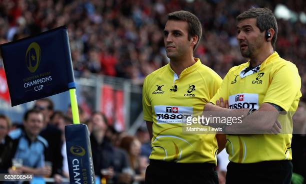 Referee Jerome Garces consults a TV replay with the linesman after Chris Ashton of Saracens try was disallowed during the European Rugby Champions...