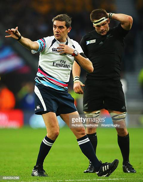 Referee Jerome Garces gives a decision against New Zealand as captain Richie McCaw of the New Zealand All Blacks looks on during the 2015 Rugby World...