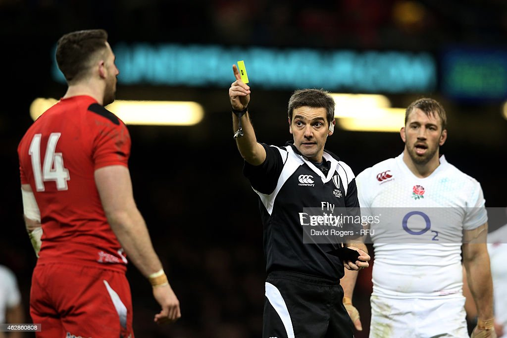 Referee Jerome Garces of France shows the yellow card to Alex Cuthbert of Wales during the RBS Six Nations match between Wales and England at the...