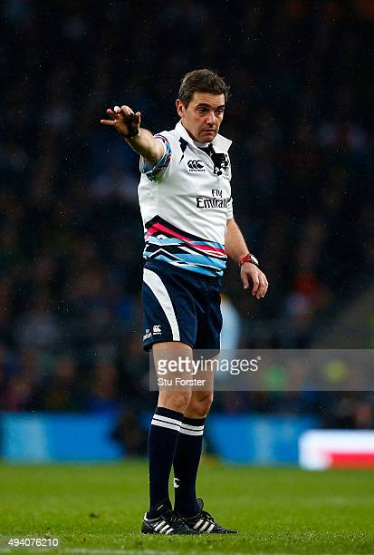 Referee Jerome Garces points during the 2015 Rugby World Cup Semi Final match between South Africa and New Zealand at Twickenham Stadium on October...
