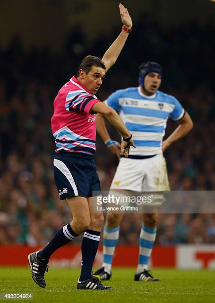 Referee Jerome Garces signals during the 2015 Rugby World Cup Quarter Final match between Ireland and Argentina at the Millennium Stadium on October...