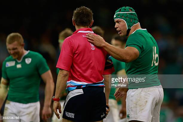 Referee Jerome Garces speaks with Richardt Strauss of Ireland during the 2015 Rugby World Cup Quarter Final match between Ireland and Argentina at...