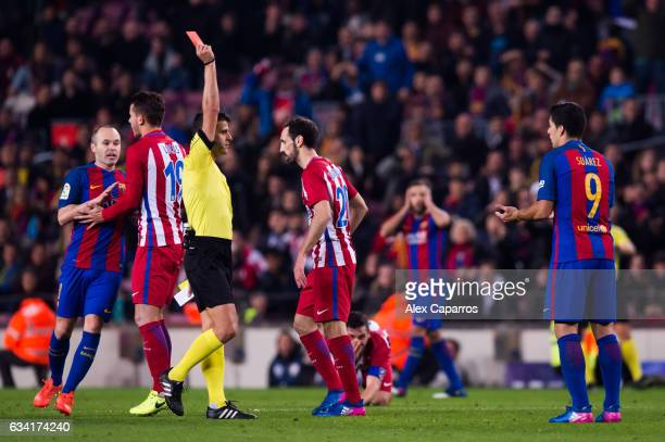 Referee Jesus Gil Manzano shows a red card to Luis Suarez of FC Barcelona during the Copa del Rey semifinal second leg match between FC Barcelona and...