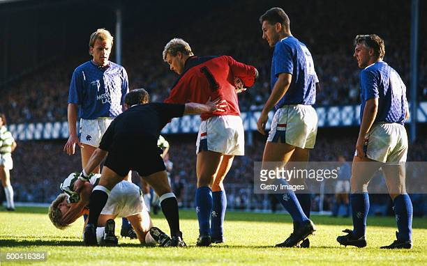 Referee Jim Duncan seperates Celtic striker Frank McAvennie from Rangers goalkeeper Chris Woods whilst John McGregor Terry Butcher and Graham Roberts...