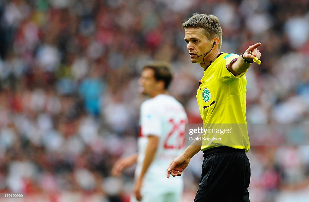 Referee Jochen Drees points during the Bundesliga match between VfB Stuttgart and 1899 Hoffenheim at Mercedes-Benz Arena on September 1, 2013 in Stuttgart, Germany.
