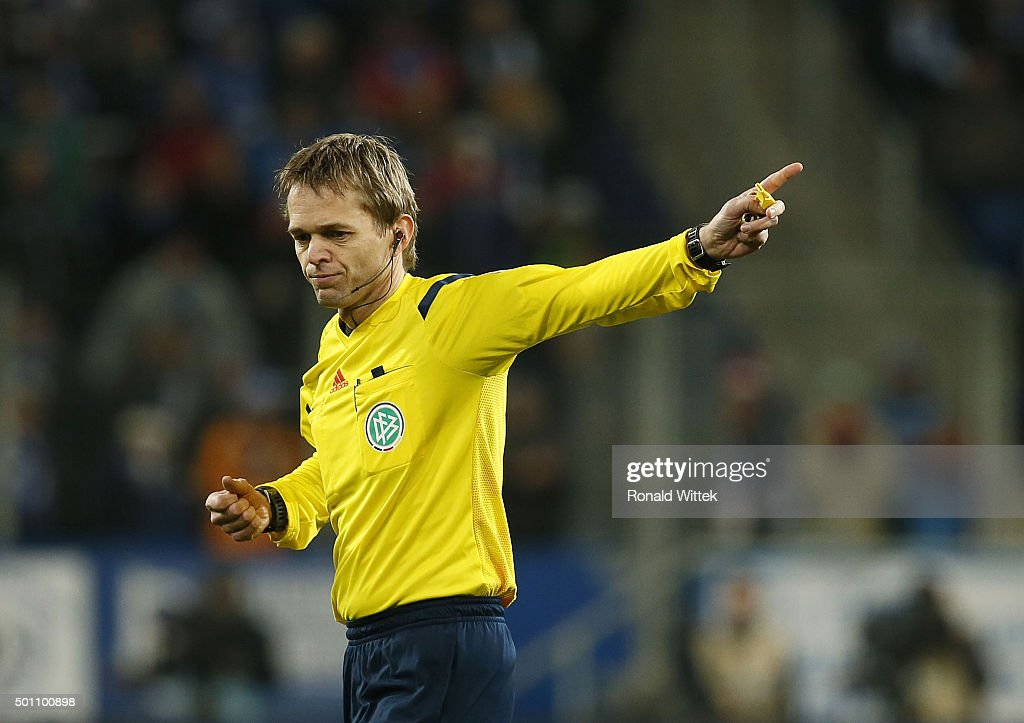 Referee <a gi-track='captionPersonalityLinkClicked' href=/galleries/search?phrase=Jochen+Drees&family=editorial&specificpeople=801383 ng-click='$event.stopPropagation()'>Jochen Drees</a> reacts during the Bundesliga match between 1899 Hoffenheim and Hannover 96 at Wirsol Rhein-Neckar-Arena on December 12, 2015 in Sinsheim, Germany.