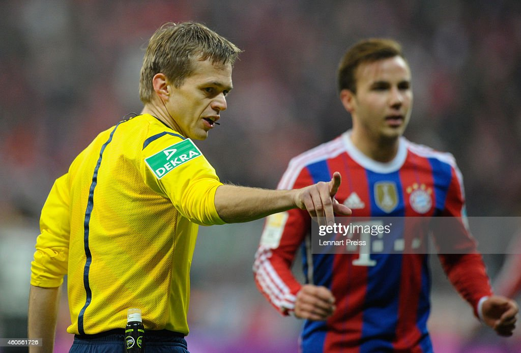 Referee <a gi-track='captionPersonalityLinkClicked' href=/galleries/search?phrase=Jochen+Drees&family=editorial&specificpeople=801383 ng-click='$event.stopPropagation()'>Jochen Drees</a> reacts during the Bundesliga match between FC Bayern Muenchen and SC Freiburg at Allianz Arena on December 16, 2014 in Munich, Germany.
