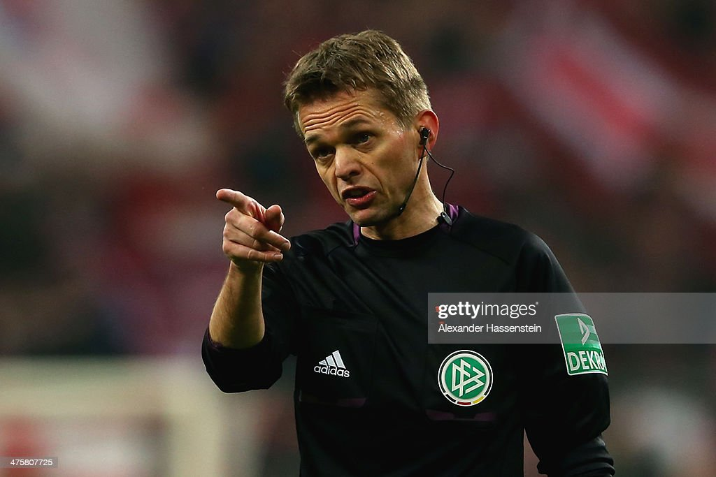 Referee <a gi-track='captionPersonalityLinkClicked' href=/galleries/search?phrase=Jochen+Drees&family=editorial&specificpeople=801383 ng-click='$event.stopPropagation()'>Jochen Drees</a> reacts during the Bundesliga match between FC Bayern Muenchen and FC Schalke 04 at Allianz Arena on March 1, 2014 in Munich, Germany.