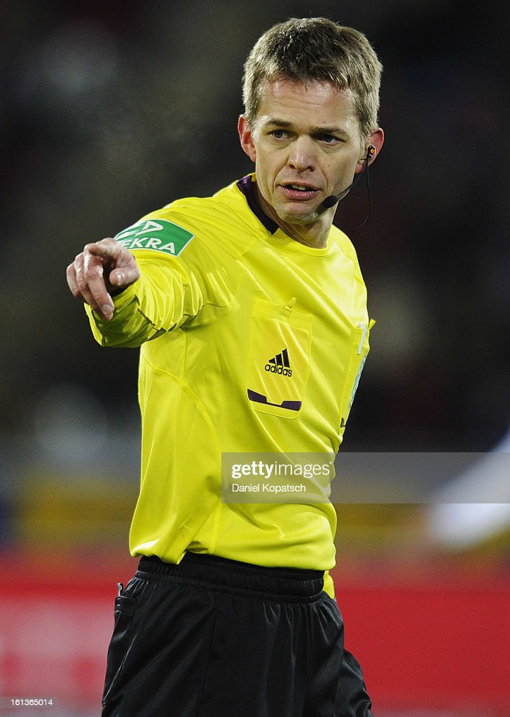 Referee <a gi-track='captionPersonalityLinkClicked' href=/galleries/search?phrase=Jochen+Drees&family=editorial&specificpeople=801383 ng-click='$event.stopPropagation()'>Jochen Drees</a> reacts during the Bundesliga match between SC Freiburg and Fortuna Duesseldorf 1895 at MAGE SOLAR Stadium on February 10, 2013 in Freiburg im Breisgau, Germany.
