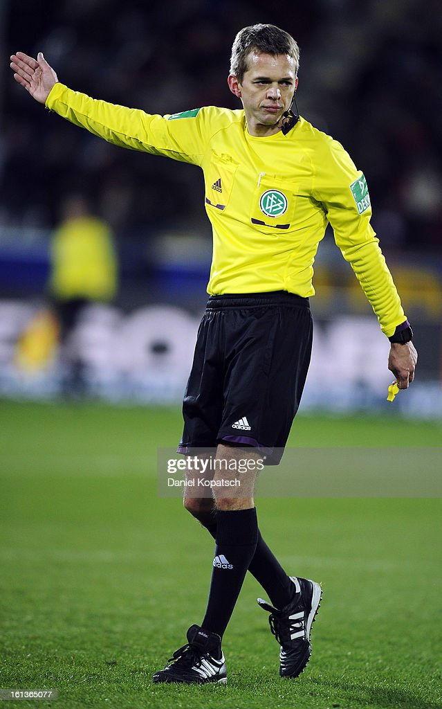 Referee Jochen Drees reacts during the Bundesliga match between SC Freiburg and Fortuna Duesseldorf 1895 at MAGE SOLAR Stadium on February 10, 2013 in Freiburg im Breisgau, Germany.
