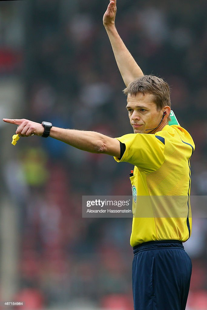 Referee <a gi-track='captionPersonalityLinkClicked' href=/galleries/search?phrase=Jochen+Drees&family=editorial&specificpeople=801383 ng-click='$event.stopPropagation()'>Jochen Drees</a> reacts during the Bundesliga match between VfB Stuttgart and Eintracht Frankfurt at Mercedes-Benz Arena on March 21, 2015 in Stuttgart, Germany.