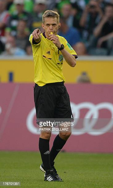 Referee Jochen Drees reacts during the German first division Bundesliga football match Borussia Moenchengladbach vs Hanover 96 in the German city of...