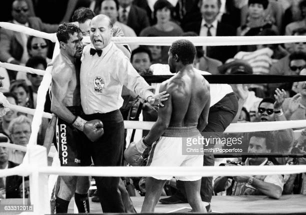 Referee Joe Cortez comes between boxers Azumah Nelson of Ghana and Jeff Fenech of Australia in Las Vegas on 28th June 1991 The bout ended in a draw...