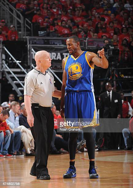 Referee Joe Crawford and Andre Iguodala of the Golden State Warriors speak during a game against the Houston Rockets in Game Four of the Western...