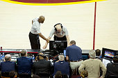 NBA referee Joe Crawford and Derrick Stafford reviews a play from the replay center in Secaucus NJ during the game between the Cleveland Cavaliers...