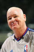 Referee Joe Crawford cracks a smile during the game between the San Antonio Spurs and the Sacramento Kings at Arco Arena on November 19 2006 in...