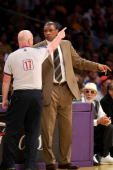 Referee Joe Crawford explains a call to head coach Doc Rivers of the Boston Celtics in the first half against the Los Angeles Lakers in Game Three of...