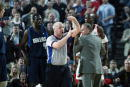 Referee Joe Crawford hands out a technical foul during the game between the Dallas Mavericks and the Portland Trail Blazers in Game three of the...