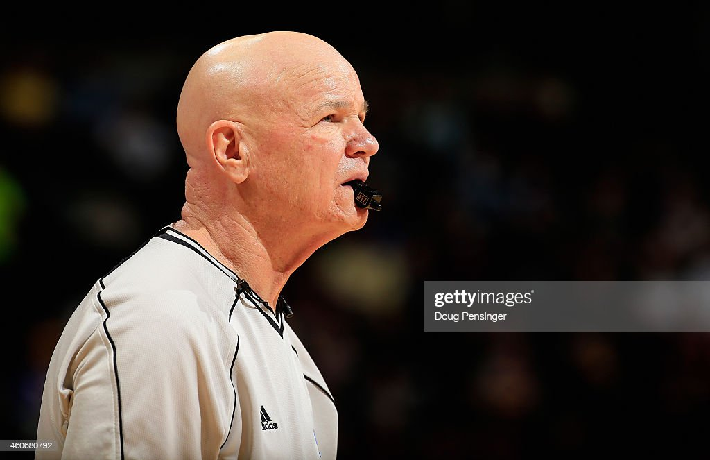 Referee Joe Crawford #17 oversees the action between the Houston Rockets and the Denver Nuggets at Pepsi Center on December 17, 2014 in Denver, Colorado. The Rockets defeated the Nuggets 115-111 in overtime.