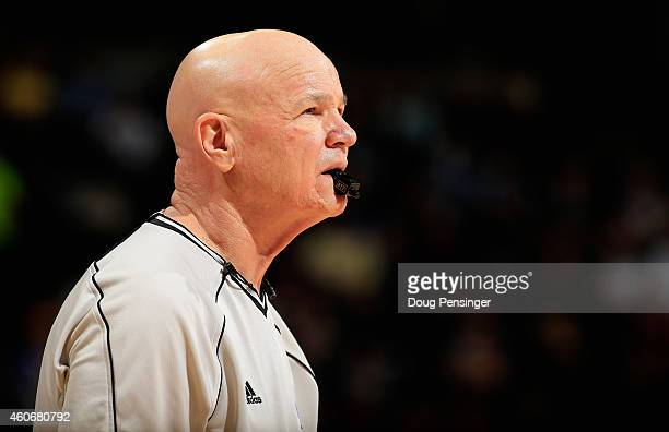 Referee Joe Crawford oversees the action between the Houston Rockets and the Denver Nuggets at Pepsi Center on December 17 2014 in Denver Colorado...