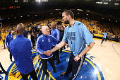 NBA referee Joe Crawford shakes hands with Marc Gasol of the Memphis Grizzlies before the game against the Golden State Warriors in Game One of the...
