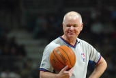 Referee Joe Crawford smiles during the game between the Seattle Sonics and the Milwaukee Bucks at the Bradley Center on November 12 2003 in Milwaukee...