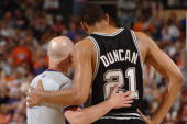 Referee Joe Crawford talks to Tim Duncan of the San Antonio Spurs in Game one of the Western Conference Finals against the Phoenix Suns during the...