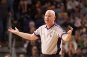 Referee Joe Crawford throws up his arms during the game between the Phoenix Suns and the Indiana Pacers on March 2 at US Airways Center in Phoenix...