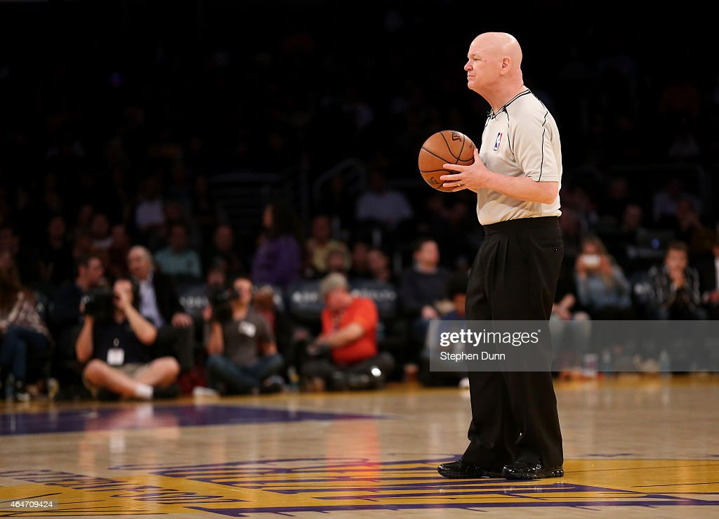 Referee Joe Crawford waits to throw up the opening tipoff for game between the Milwaukee Bucks and the Los Angeles Lakers at Staples Center on February 27, 2015 in Los Angeles, California.