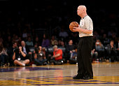 Referee Joe Crawford waits to throw up the opening tipoff for game between the Milwaukee Bucks and the Los Angeles Lakers at Staples Center on...