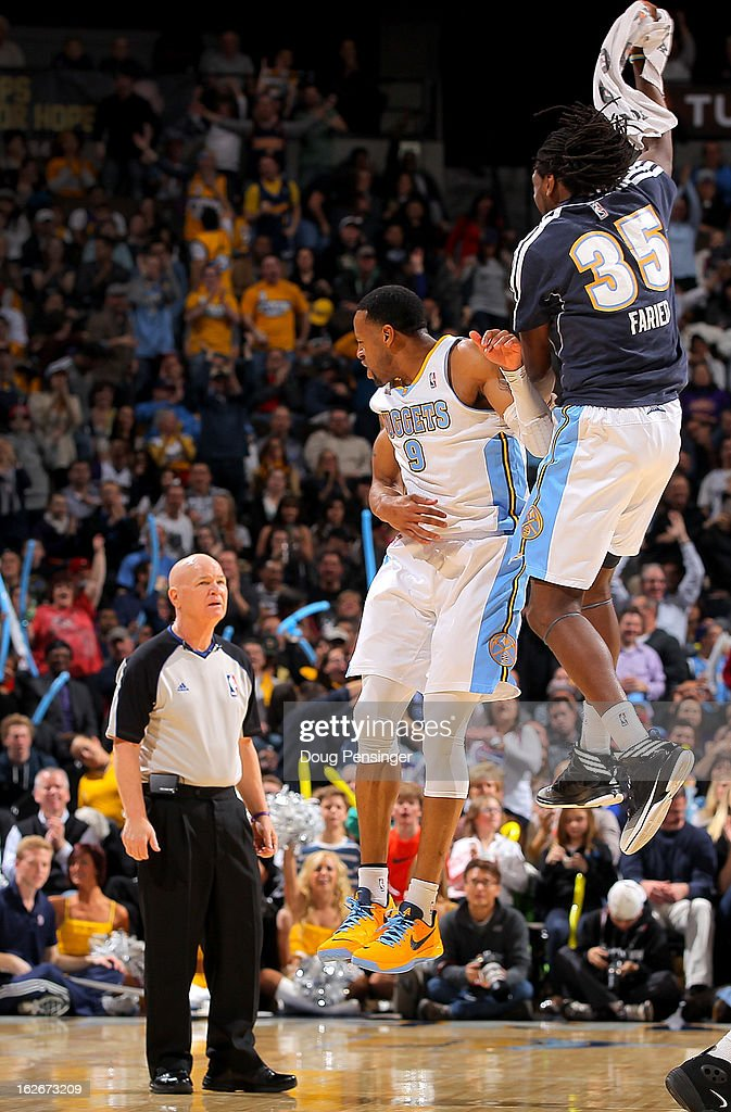 Referee Joe Crawford #17 watches as Andre Iguodala #9 of the Denver Nuggets and Kenneth Faried #35 of the Denver Nuggets celebrate a play against the Los Angeles Lakers at the Pepsi Center on February 25, 2013 in Denver, Colorado. The Nuggets defeated the Lakers 119-108.