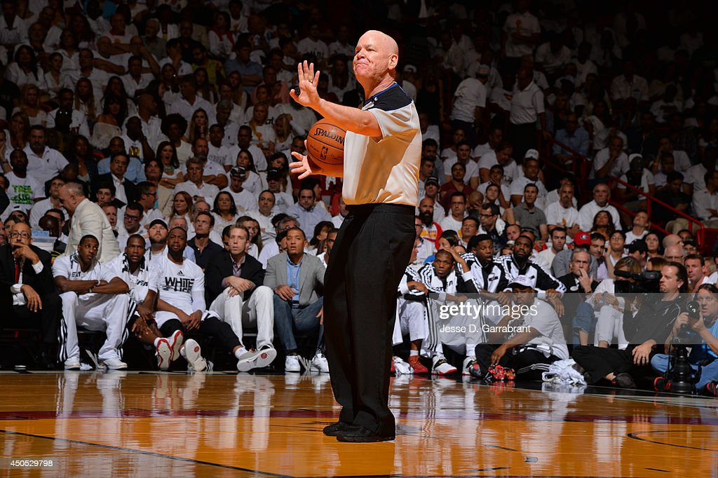 Referee <a gi-track='captionPersonalityLinkClicked' href=/galleries/search?phrase=Joey+Crawford&family=editorial&specificpeople=559119 ng-click='$event.stopPropagation()'>Joey Crawford</a> calls a foul during the San Antonio Spurs against the Miami Heat during Game Six of the 2014 NBA Finals on June 12, 2014 at American Airlines Arena in Miami, Florida.