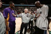 Referee Joey Crawford holds the pregame caption meetings at center court with Kevin Garnett of the Minnesota Timberwolves and Kobe Bryant of the Los...