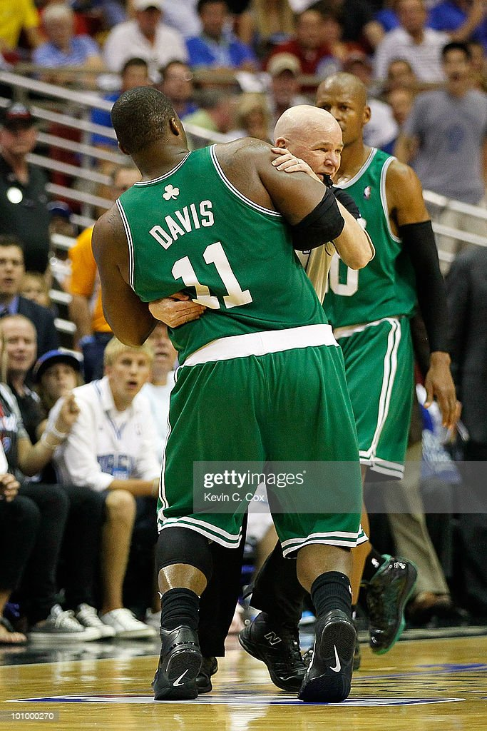 Referee Joey Crawford holds up <a gi-track='captionPersonalityLinkClicked' href=/galleries/search?phrase=Glen+Davis+-+Basketballer&family=editorial&specificpeople=709385 ng-click='$event.stopPropagation()'>Glen Davis</a> #11 of the Boston Celtics due to Davis being disoriented after he took an elbow to the head from Dwight Howard #12 of the Orlando Magic in the third quarter of Game Five of the Eastern Conference Finals during the 2010 NBA Playoffs at Amway Arena on May 26, 2010 in Orlando, Florida.