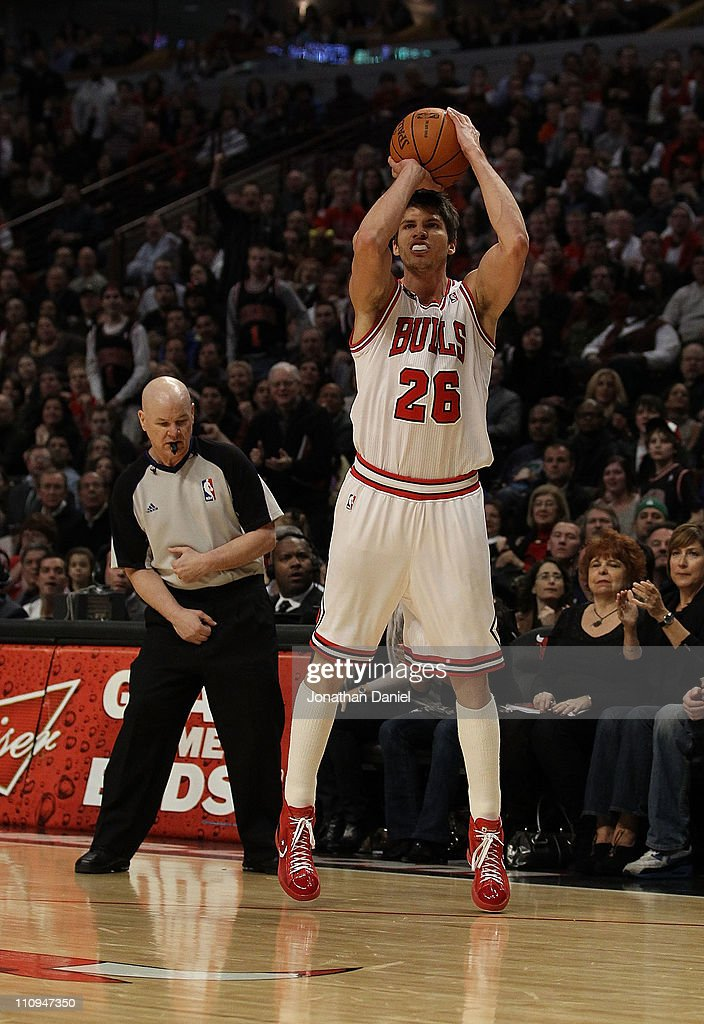 Referee Joey Crawford #17 looks to see if Kyle Korver #26 of the Chicago Bulls successfully shoots a 3 point shot against the Memphis Grizzlies at the United Center on March 25, 2011 in Chicago, Illinois. The Bulls defeated the Grizzlies 99-96.